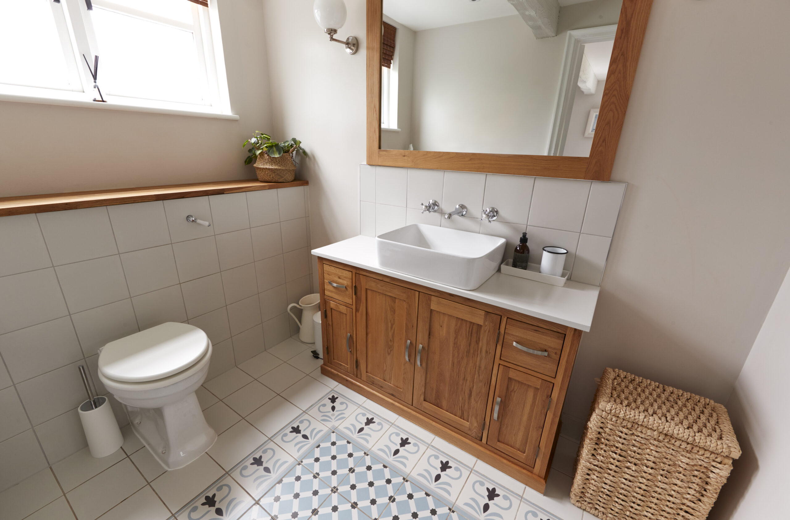 Interior View Of Beautiful Bathroom With Wash Basin And WC  In Family Home