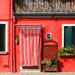Red house on Burano island in Venice, Italy