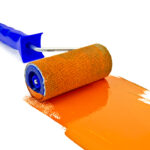 Roller paint with orange paint and a blue handle isolated on white background